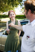 Woman being given keys to car. Hypnosis can help you pass your driving test.