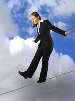 Picture of a woman on a tightrope - in control